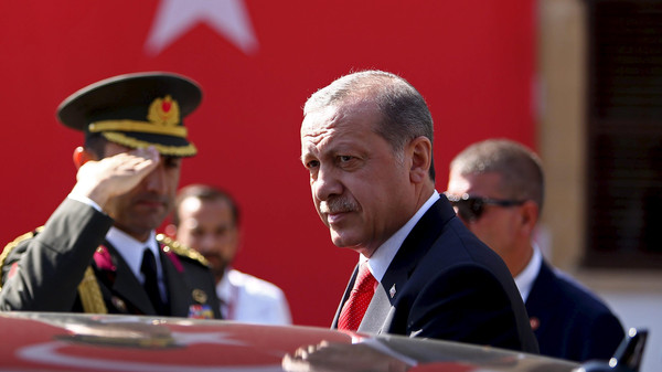 Turkey's President Tayyip Erdogan looks on durin his visit to Northern Cyprus